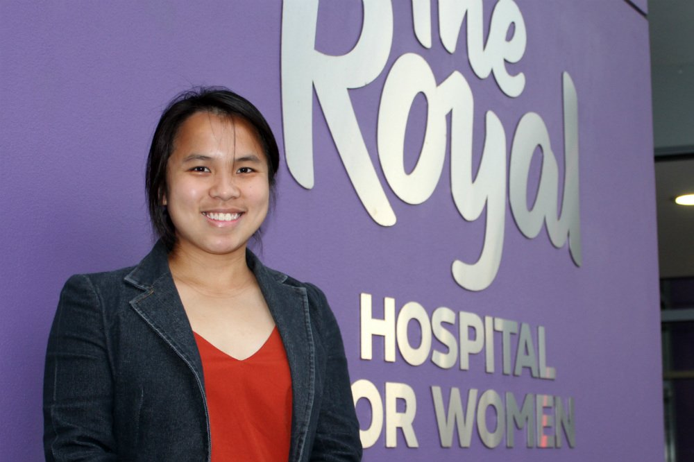 Lady in front of Royal Hospital For Women sign