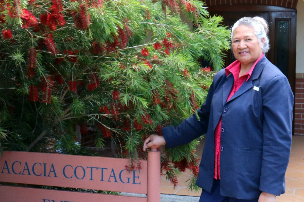 Lady in front of wattle tree
