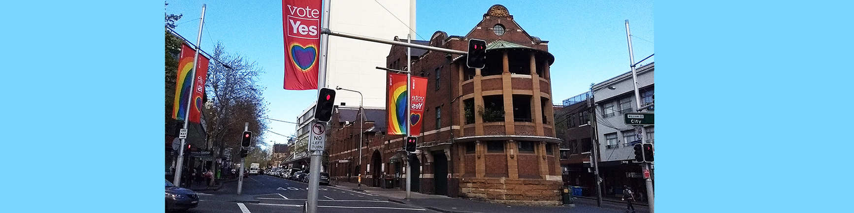 Exterior of the Kirketon Road Centre showing heritage architecture and rainbow street flags in support of the 'Yes' campaign for marriage equality.
