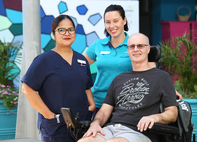 Photo of staff with spinal patient