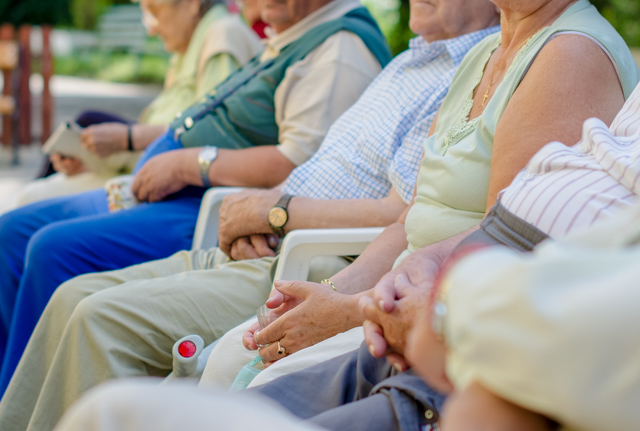 Older adults sitting on a bench. SESLHD PHU provides support and advice to aged care facilities and older adults on infection control and outbreak management