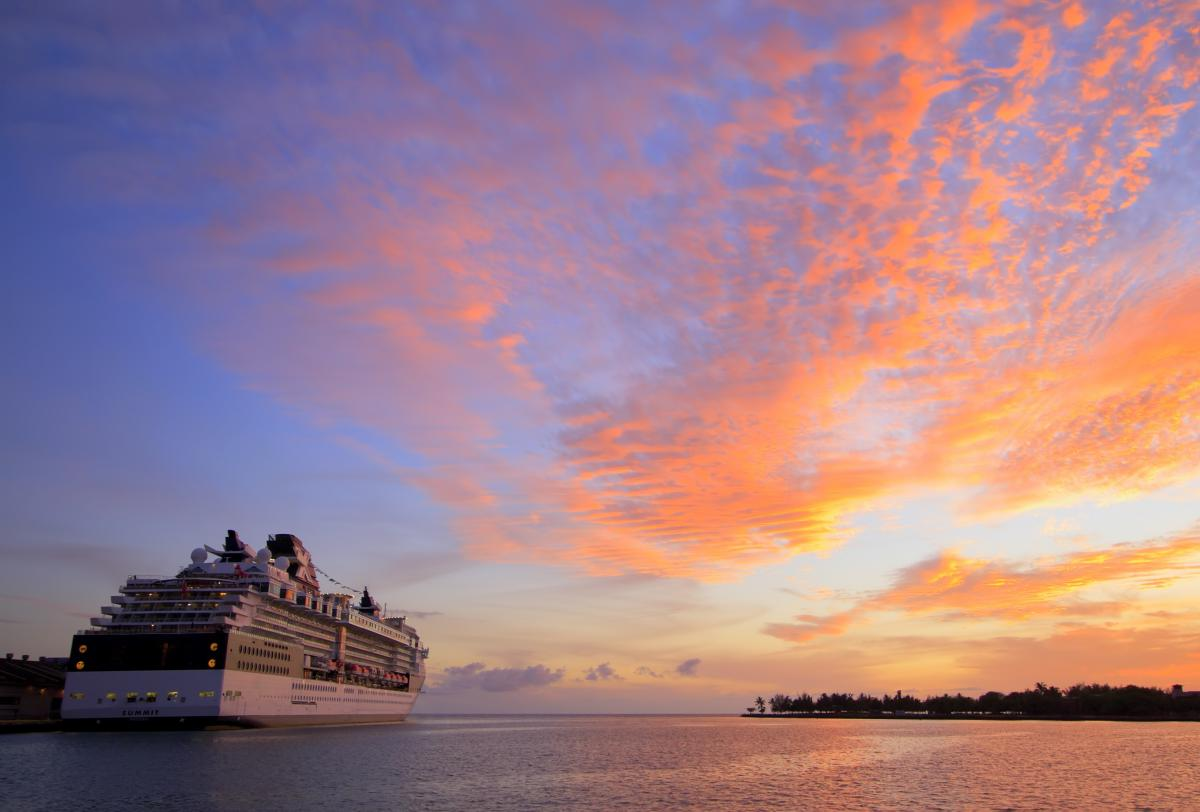 Cruise ship in sunset. The Sydney Cruise Ship Health Surveillance Program works to improve health surveillance on cruise ships and respond to outbreaks of infectious disease.