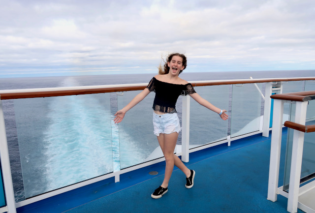 Girl on cruise ship deck.Cruise ships have become a popular mode of holiday travel, attracting large numbers of people from all over the world.