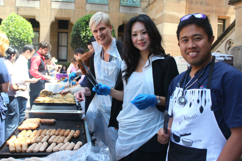 Hospital staff serving bbq lunch