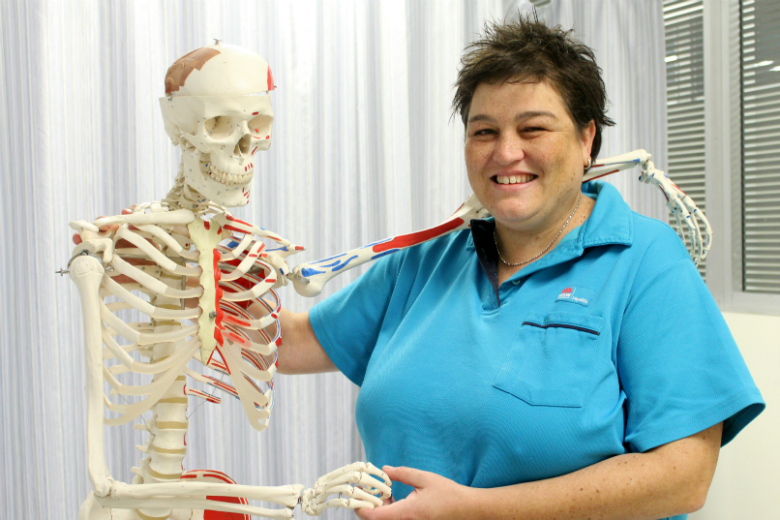 Woman with arm around teaching skeleton