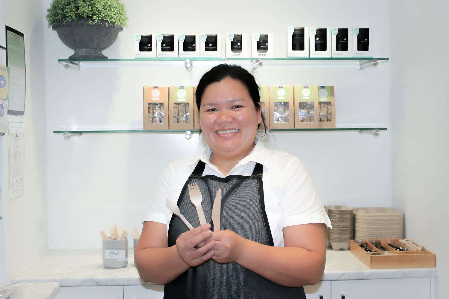 Jenny Abellera showcasing the bamboo cutlery offered by The Street Canteen