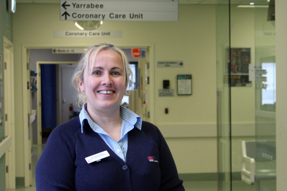 Nurse standing in hospital hallway