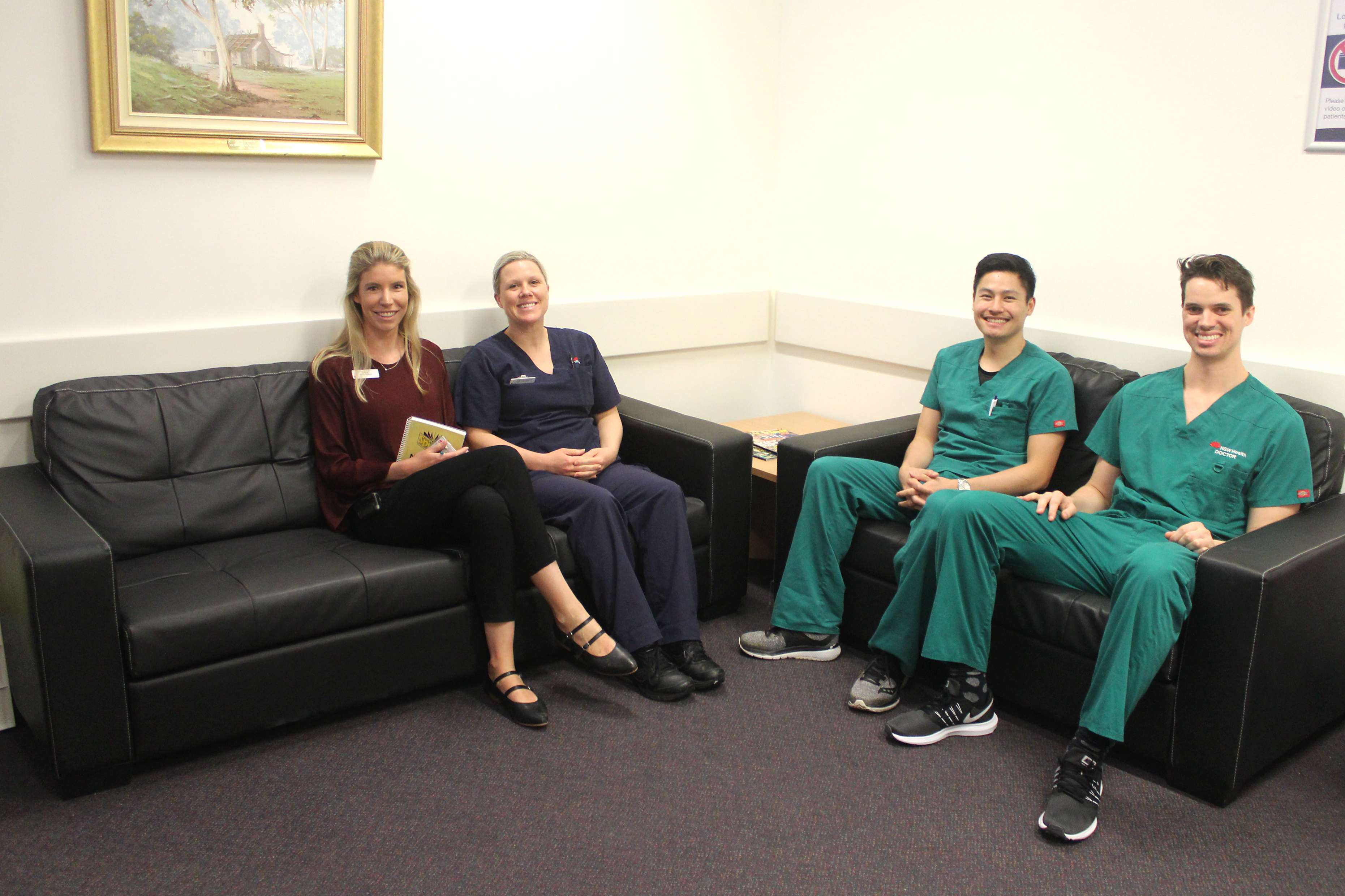 Nurses from the Intensive Care Unit sitting on the couches smiling