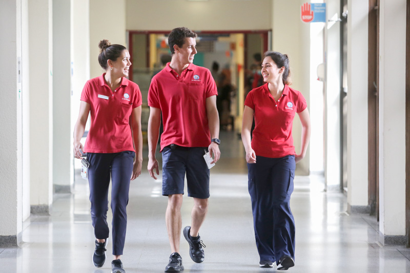 Physiotherapy staff walking in hospital ward